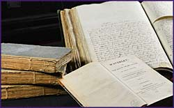 Photo of a manuscript and books