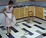 Woman mopping a floor, 1960s