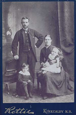 Photo of mother, father and 2 children