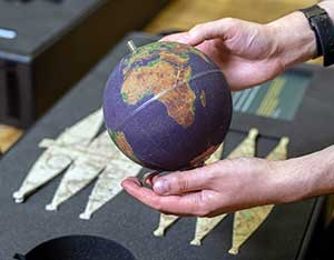 Hands holding a world globe
